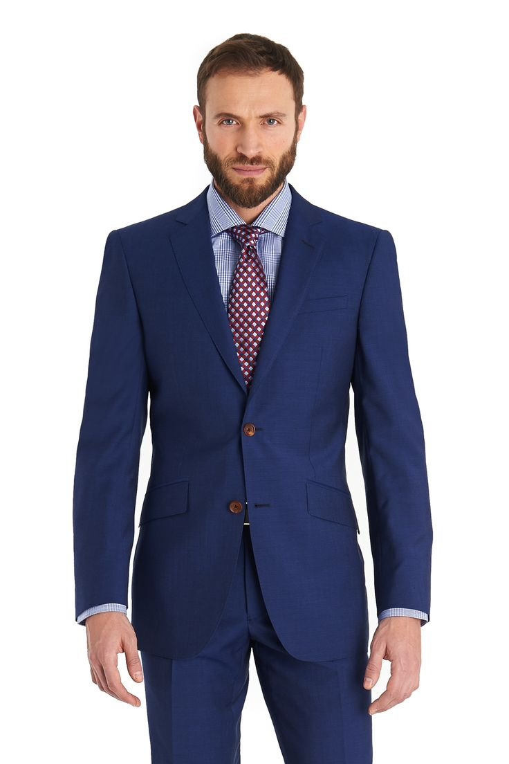 Moss 1851 single breasted two button suit with flat front trousers made out of super 100s wool and mohair blend cloth .