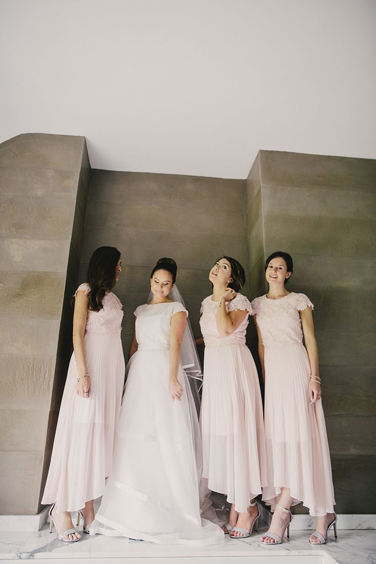 Pink bridesmaid dresses with grey stiletto heels for Elizabeth who wore a Jesus Peiro contemporary capped sleeve striped wedding dress from Miss Bush luxury bridal boutique in Surrey, for her relaxed, intimate Dorset country house wedding.    Image ©️ Marshal Gray Photography