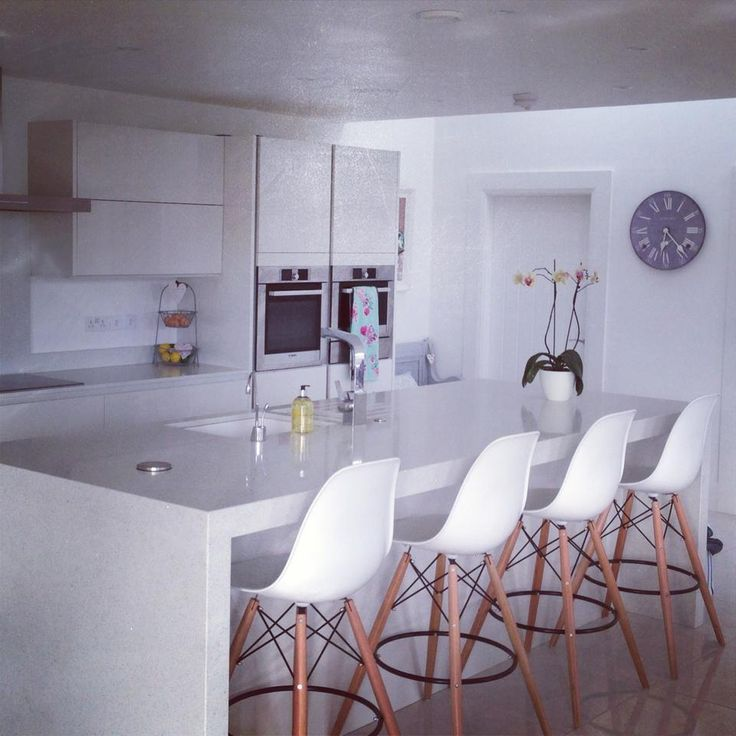 A customers beautiful kitchen finished off with   our DSW bar stools available from http://www.lakeland-furniture.co.uk/eames-dsw-bar-stools-white.html for ONLY £79.99