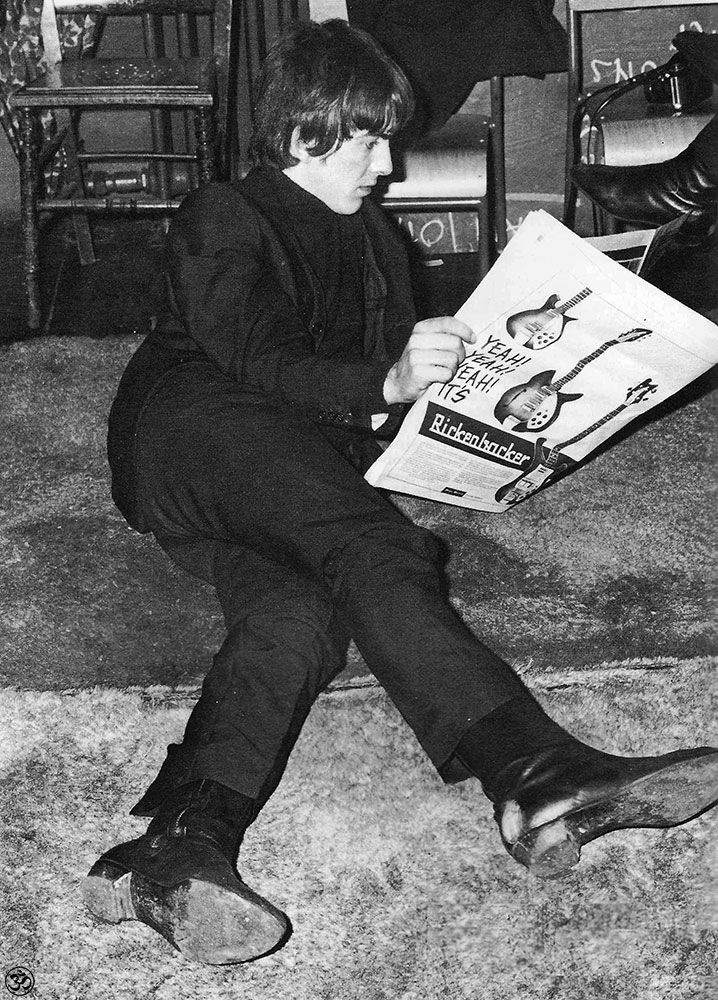 Georgie lounging about, relaxing & reading about guitars.