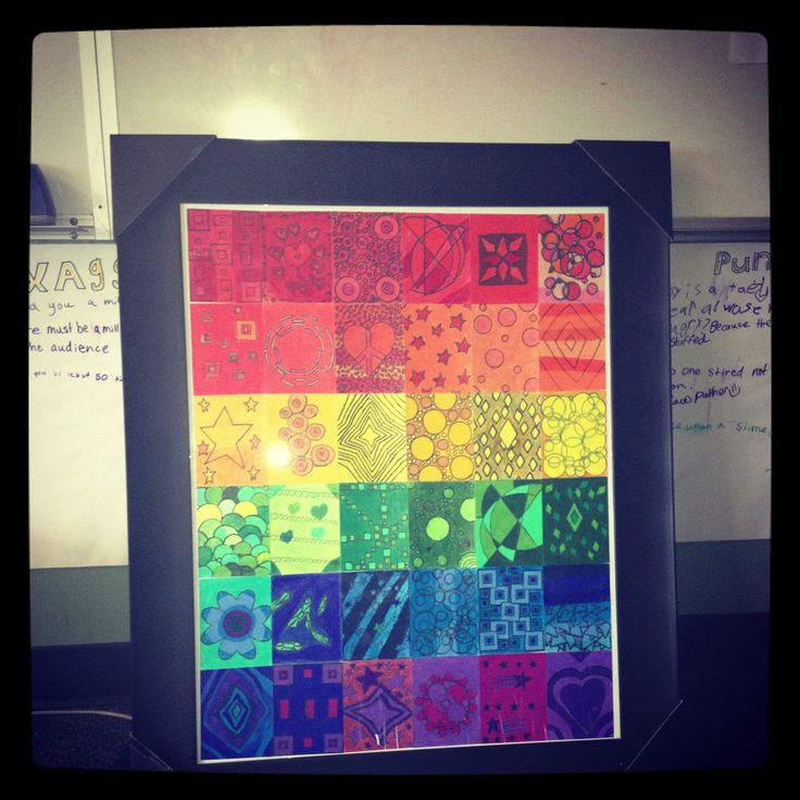 My class auction project for 2013. We brainstormed 6 shapes and 6 colors, assigned a number (1 - 6) to each shape and color, the kids rolled the virtual dice on my iPhone to see what shape and color they were in charge of and then designed and colored using colored pencils.