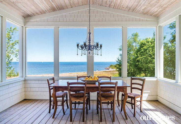 "The screened porch offers both a lounge area and a dining table with a view of Georgian Bay's stunning waters.     See more of this home in ""Cape Cod Style Home on the Shores of Georgian Bay"" from OUR HOMES Southern Georgian Bay, Summer 2017 http://www.ourhomes.ca/articles/build/article/cape-cod-style-home-on-the-shores-of-georgian-bay"