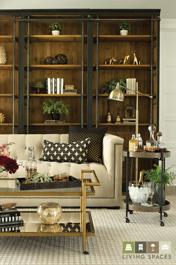 From Living Spaces Glisten Up Any Room With Elegant Metallics The Bronze Finished Rosalind Cocktail Table Adds