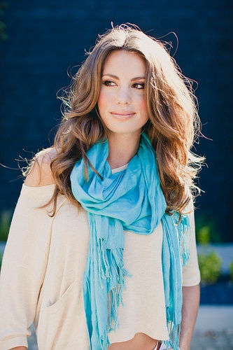 love the scarf.. maybe bring out the blue in my eyes??? or at least the ocean..