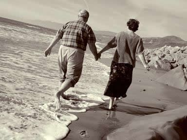 You're never too old for walking down the beach hand in hand,