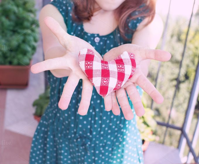 Heart in open hands of a child by Life Morning Photography on Creative Market