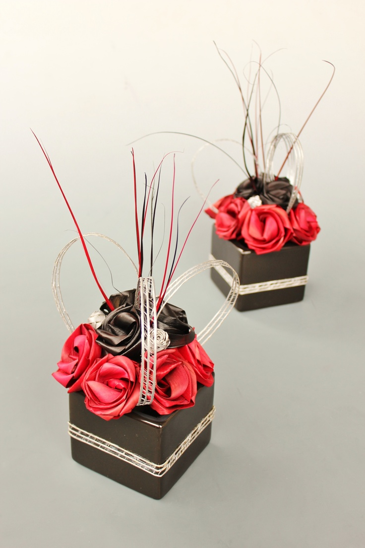 Ceramic cube centrepieces with flax flowers in red, black and silver.  www.flaxation.co.nz