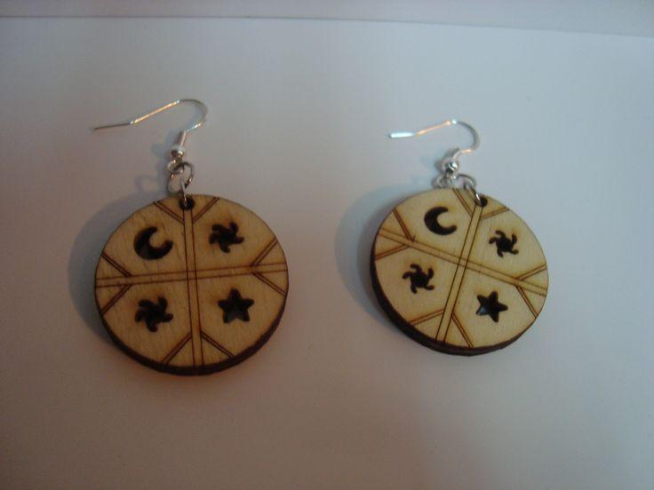 Aros en madera Kultrun  $1.000