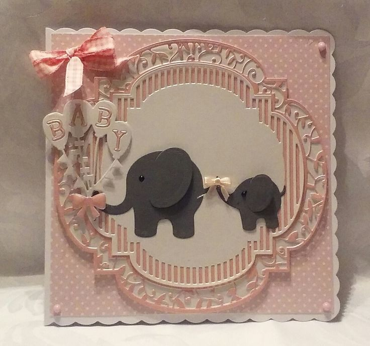 Made by Carole Dodgson - I made this card using the Twisted Veranda Layering Die Sets and the Baby Love Inspirations Die Set the I finished it off with Nuvo Drops