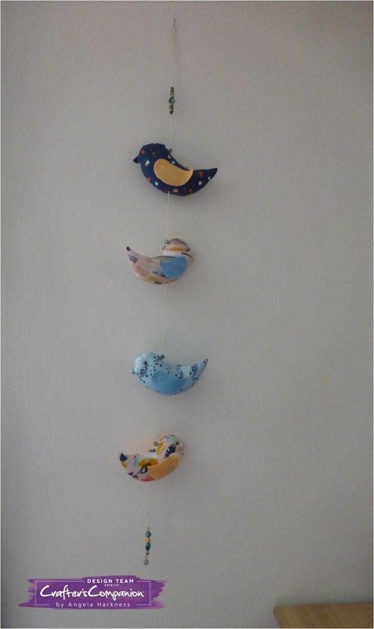 Hanging bird garland using Debbie Shore Bird Template.  Designed by Angela Harkness #crafterscompanion