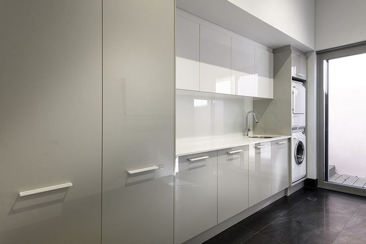 Custom made Laundry Renovation. High gloss doors and a subtle dual-tone set-back overhead cupboards.
