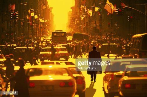 Stock Photo : BUSINESSMAN WALKING THROUGH TRAFFIC IN CROWD, GOLDEN LIGHT IN NEW YORK