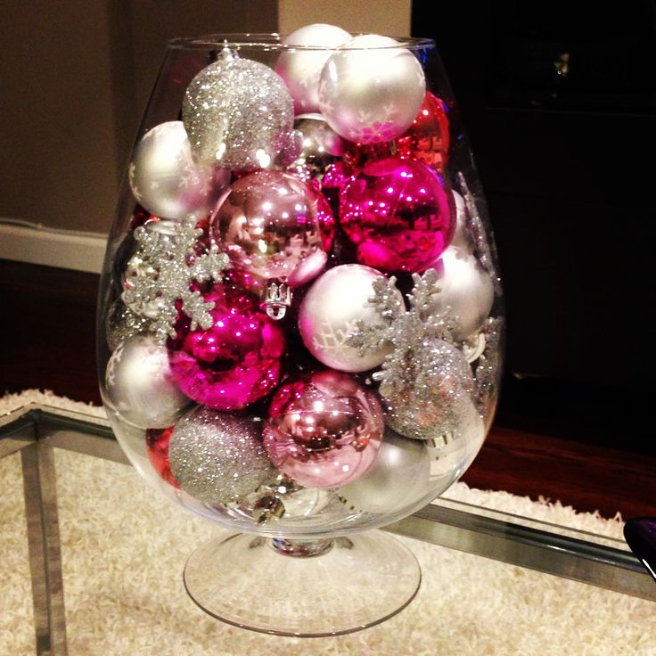 DIY Christmas decoration. Oversized wine glass vase from Marshall's. Silver balls from Ikea and pink from Target. Simple and pretty.
