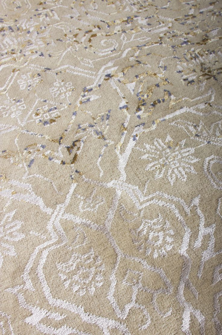"""DUST inteprets the traditional patterns in a modern way, where the colours are """"erased"""" on the surface of the rug. The rug is produced in the best tradition of handknotted carpets of high density in Turkish knotts."""