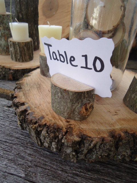 100 rustic place card holders, tree card holders, place holders, rustic wedding decor, country wedding, tree stump. $135.00, via Etsy.