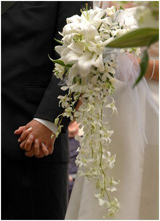 White cascade bouquet with lilies and orchids