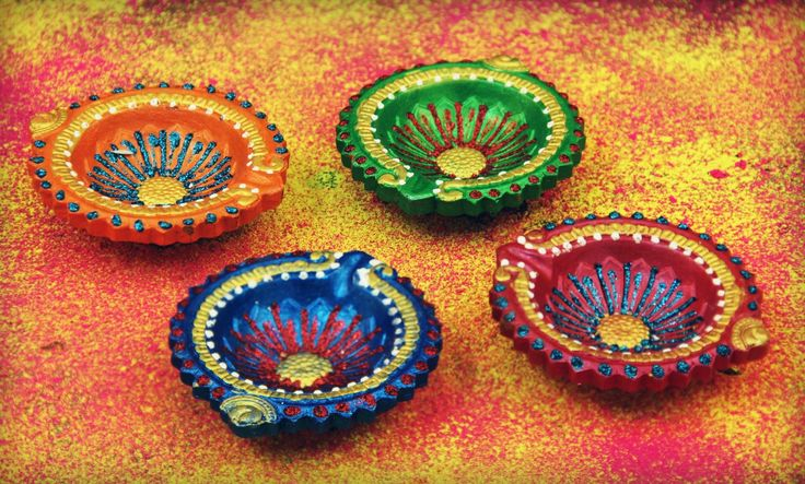 Amazon.com - Set Of 4 Traditional Earthen Hand painted Diwali Diyas Lamps In Blue Pink Green & Orange Embellished With Faux Kundan