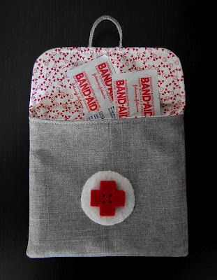 An 'ouch-pouch'. Perfect for showing kids you care - keep neosporin and cartoon bandaids and give undivided attention while helping them.