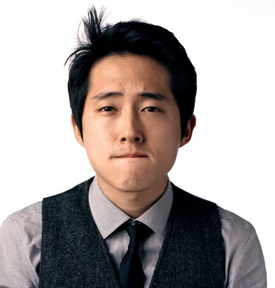 Steven Yeun.  I would stand behind him in a zombie apocaplypse