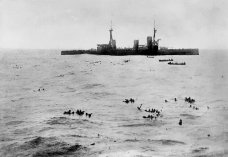 HMS Inflexible picking up sunk sailors (Battle of Falklands)
