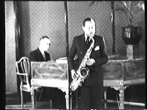 """Coleman Hawkins in Holland 1935 -  Accompanied by pianist Leo de la Fuente, Coleman Hawkins announces and plays """"I Wish That I Were Twins"""". Filmed at Pulchri Studio, Lange Voorhout, The Hague, Netherlands, this is from my own 16 mm copy which I had made from a 35 mm original which I discovered in an abandoned film archive in The Hague."""
