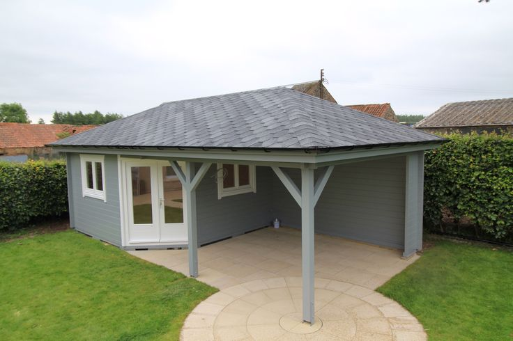 Hipped roof log cabin and open veranda, by Log Cabins Scotland