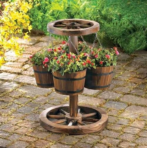 wagon wheel planter: Wagonwheel, Wagon Wheels, Plants Stands, Flower Pot, Gardens Idea, Westerns Decoration, Westerns Homes,  Flowerpot, Outdoor Planters