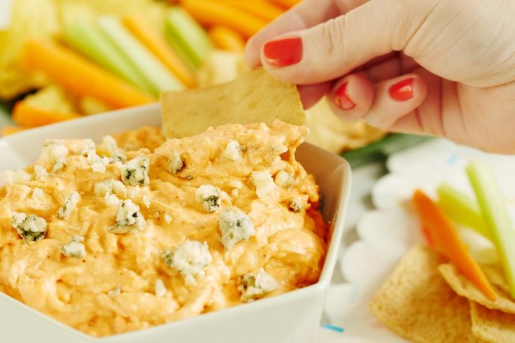 BEST Homemade buffalo chicken dip recipe. Perfect simple party food ideas for Crock Pots and slow cookers. It's the EASY, SIMPLE way to serve buffalo wings for a crowd of kids or adults. Appetizers have never tasted so good!