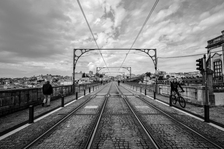 Go Across - Porto can and does boast some wonderful colors, which I love, but even today I best see its spirit in black and white.  Fujifilm X-T1 + Samyang 12mm + My edit