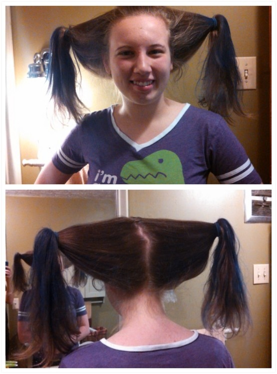 My daughter on Crazy Hair Day at school. Two soda bottles with the bottoms cut off.