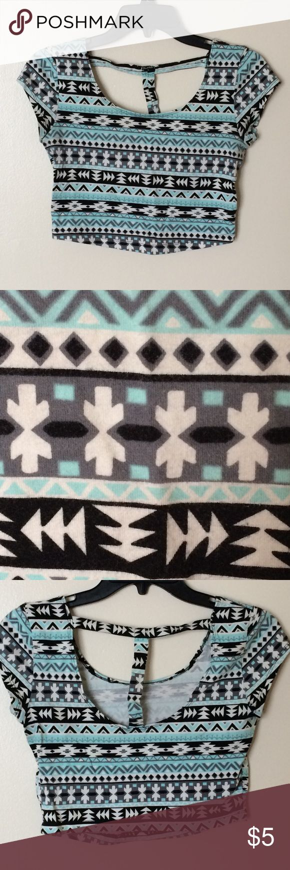 Charlotte Russe t-back Aztec crop top This turquoise, grey, black, and white shirt-sleeved Aztec-print crop top is made by Charlotte Russe. It features an open back with a t-strap. It is in excellent used condition and comes from a smoke free, pet free home. Charlotte Russe Tops Crop Tops