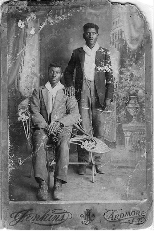 Gay Black couple at the turn of the century.