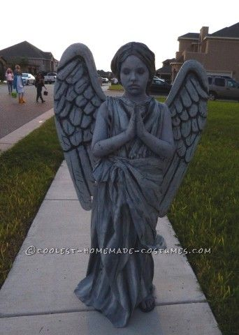 My daughter asked me to make her a Guardian Angel Statue costume for Halloween. Because she is in school most of the day, I wrapped her in packing tap...