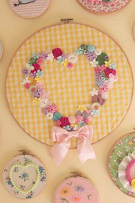 Button heart on gingham in embroidery hoop--made by Chelsea Ann & seen on her inspiring blog ittybittybirdy.blogspot.com.  It looks adorable hanging in her daughter's bedroom, surrounded by other pretty hoops!