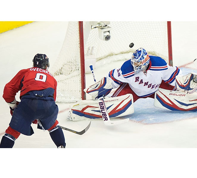 Alex Ovechkin scores a second-period power-play goal against the Rangers Henrik Lundqvist to tie the game 1-1.