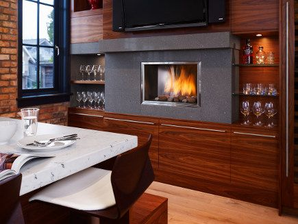 Contemporary Downsview cabinet kitchen with fireplace in the wall -- wine & fire!