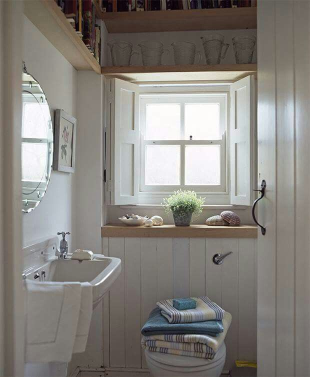 small bathroom decorating ideas with high shelving above the window frame wall mounted sink panelling