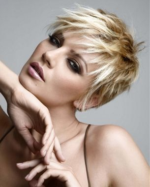 A short blonde straight choppy hairstyle by Royston Blythe