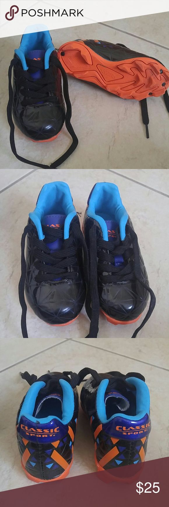 Toddler soccer cleats size 7T black & orange/blue Classic sport toddler cleats for your little soccer star. Size 7T. My son wore these once but they did not fit. My son has a wide foot. Would fit an average width.   These are very high quality soccer cleats and have only signs of use on the bottoms. Comes in original box. Classic sport  Shoes Sneakers