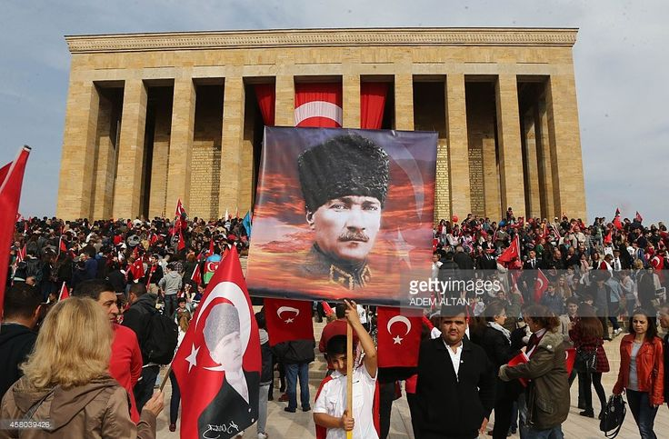People gather with Turkish flags and portraits of Mustafa Kemal Ataturk, the first president of Turkey, on October 29, 2014 during Turkish Republic Day celebration, marking the 91st anniversary of its foundation, at the Ataturk Mausoleum, also known as Anitkabir, in Ankara.