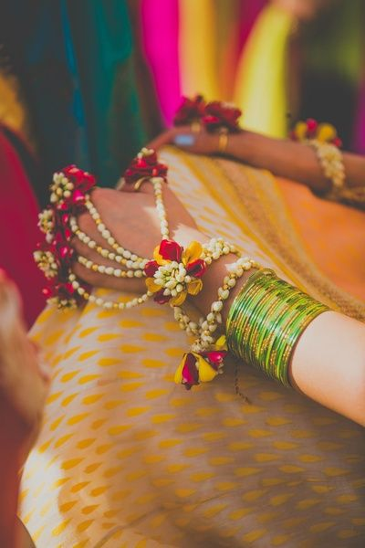 Flower jewellery on mehendi , Floral haathphool , floral white and red hand accessories, floral jewellery