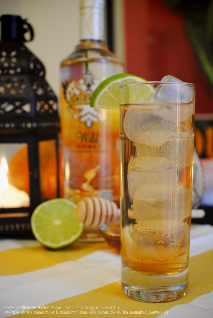 Smirnoff Wild Honey and Ginger Ale with 1.5 oz Smirnoff Wild Honey, 2.5 oz Ginger Ale, lime wedge garnish. Mix liquid ingredients in an ice-filled glass; stir well. Garnish with lime wedge.#Smirnoff #Fall #drink #recipe