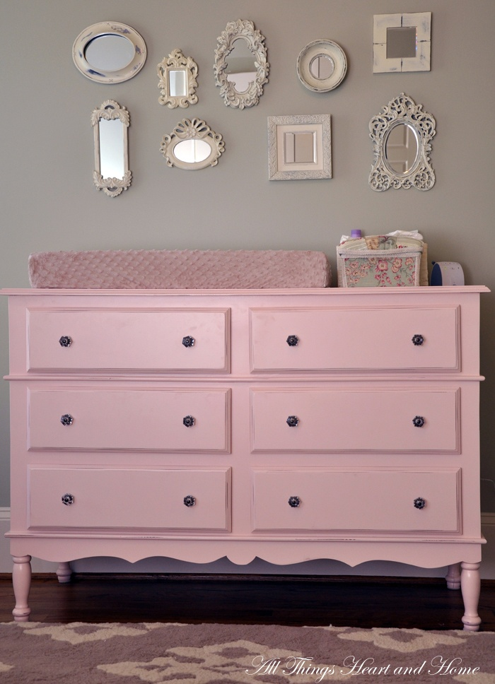 going for a very similar look! pink dresser/changer, frame collage, and possibly grey paint?