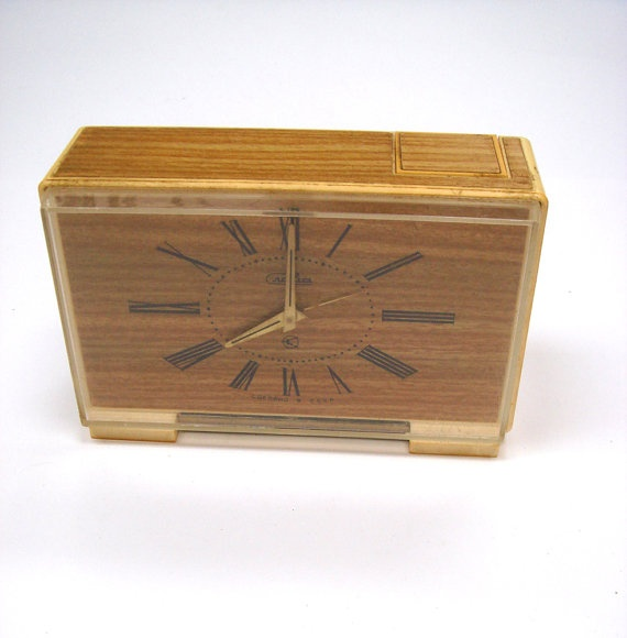 Vintage Soviet Alarm clock, Desk Accessory, Soviet Design  This elegant light brown Soviet design alarm clock looks wonderfully decorative - would be a grate interior design decor, lovely collection item or a thoughtful gift.  The small letter on front read Сделано в СССР [ made in USSR]