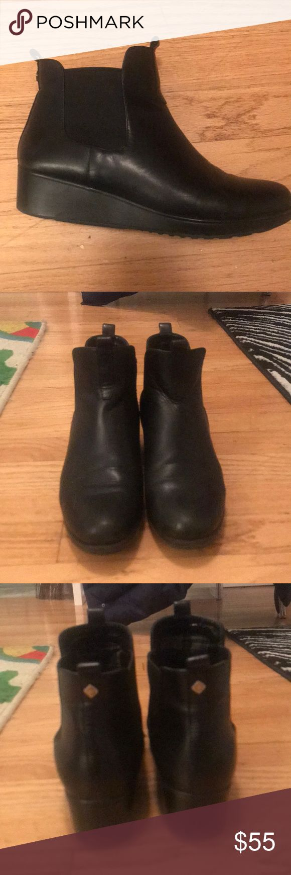 Cole Haan Waterproof wedge boots Cute and functional black waterproof boots from Cole Haan. Boots have a short, wedged heel, and elastic around the ankle. There is a small piece of gold hardware on the back of each boot as well as a dark plaid interior. These boots have had their soles reglued once. There are no noticeable defects in the leather or heels. On the tips of both shoes there is a slight separation between the uppers and soles but it is barely noticeable (pictured above). Well…