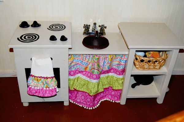 Why spend over $100 dollars on a play kitchen from Playskool, when you can make your own out of an old vanity?