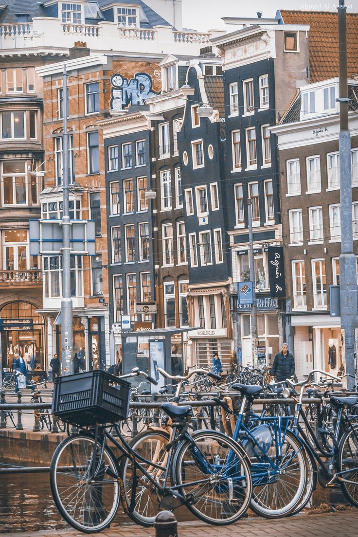 Amsterdam - Holland, some of the buildings really do look like they may soon fall over. And bikes, they are EveryWhere!!!