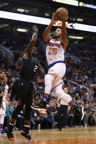 Derrick Rose #25 of the New York Knicks drives to the basket against Eric Bledsoe #2 of the Phoenix Suns during the first half of the NBA game at Talking Stick Resort Arena on December 13, 2016 in Phoenix, Arizona. NOTE TO USER: User expressly acknowledges and agrees that, by downloading and or using this photograph, User is consenting to the terms and conditions of the Getty Images License Agreement.