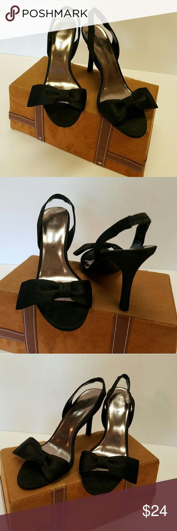 SEXY BLACK SLINGBACK  HEELS I usually shoot in 24 to 48 hours.  Great Shoes designed by Michael  Shannon.  Size 9.50 Medium.  Fabric upper.  Leather soles.  Heel height is 4.00 inches. Worn lightly.  Very Good Condition. Michael Shannon Shoes Heels