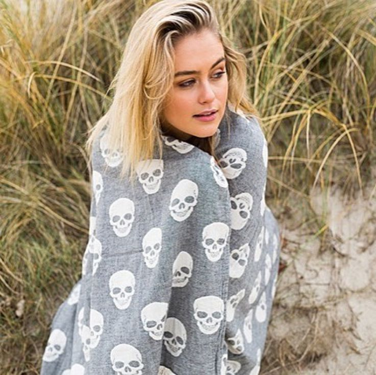 Steph Claire Smith wrapped up in our Skull Oteki….the perfect towel for seaside adventures this Summer 💕 www.knotty.com.au